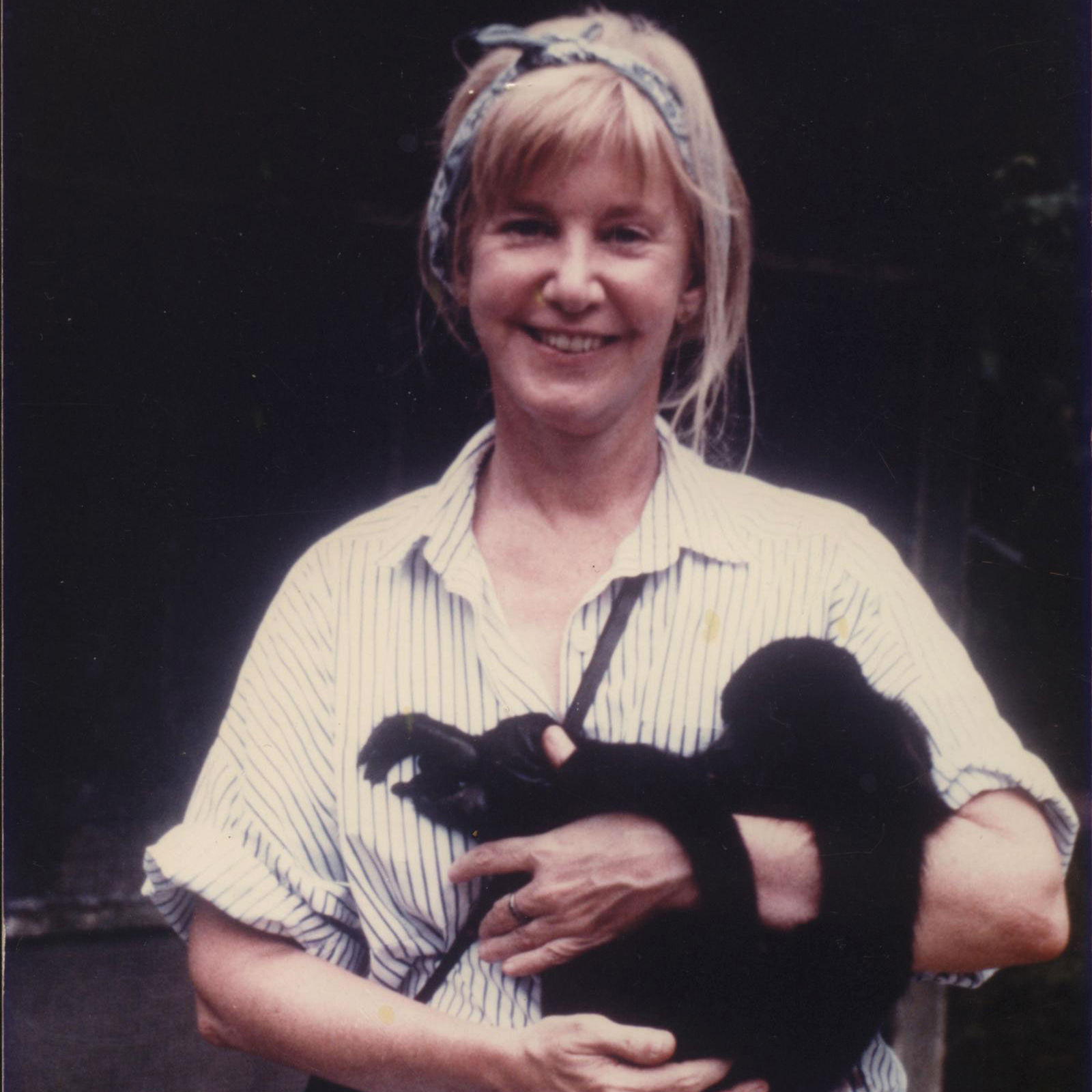 Katharine Milton holding a howler monkey