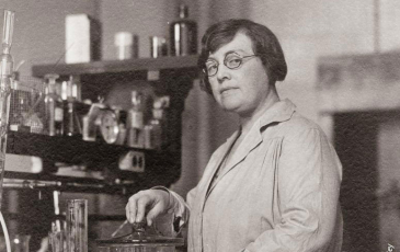Black and white photo of Agnes Morgan in a lab coat