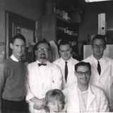 J.C. Rabinowitz Research Group, 1963. Clockwise from front: Shirley Sunden, Ted Chase, Jesse Rabinowitz, Walter Lovenburg, Sam Raeburn (seated), Bob Buchanan. PHOTO: Courtesy of Bob Buchanan.