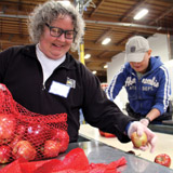 The Alameda County Community Food Bank was an early adopter in formalizing their nutrition policies. Center: Allison Pratt and Jenny Lowe manage nutrition policy. Volunteers Kathy Herman and Jigme Norby package fresh produce. PHOTO: Molly Oleson