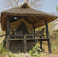 A hut in Gorongosa National Park. Reserves must accommodate and enrich the lives of people living in and near them, Wilson says. PHOTO: iStockphoto]