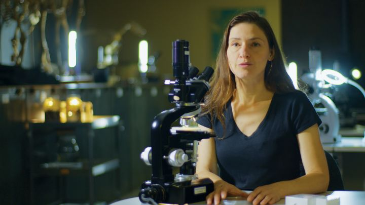 Bree Rosenblum with microscope in front