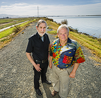 Professors and Delta Independent Science Board members Vincent Resh (right) and Richard Norgaard stand on a levee on Sherman Island along the Sacramento River.