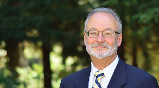 Dean J. Keith Gilless
