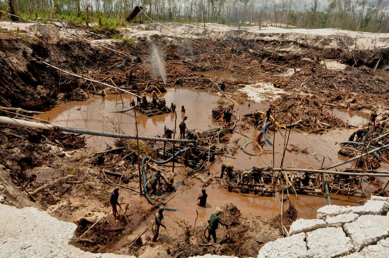 Miners in a gold mine in Indonesia
