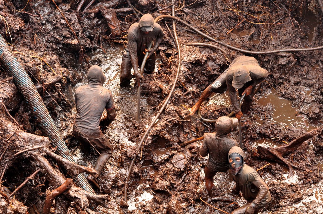 Miners in a gold mine pit in Indonesia