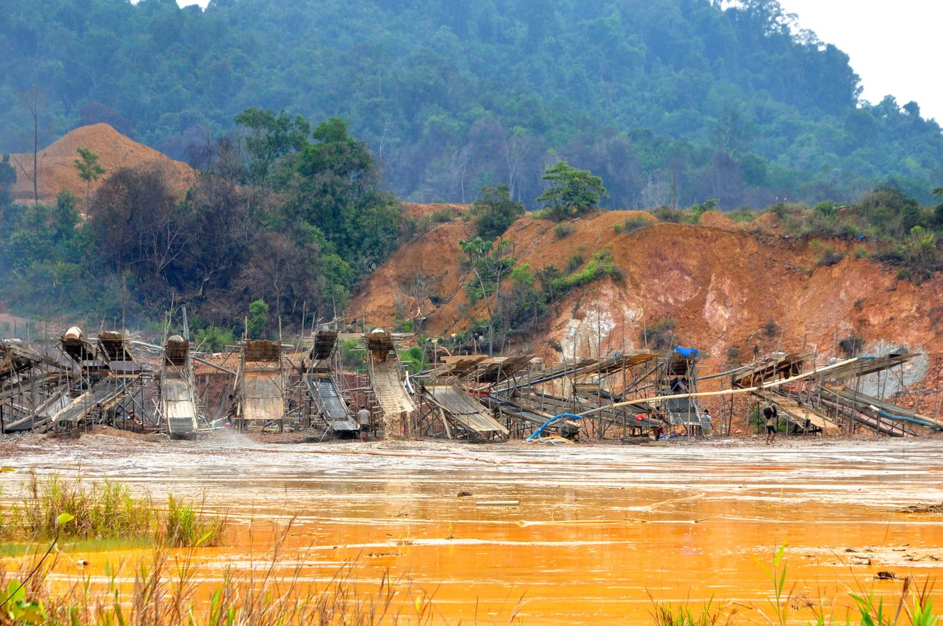 A row of sluice structures at a gold mine