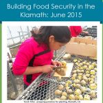 Girl prepping seed potatoes, link to June 2015 newsletter
