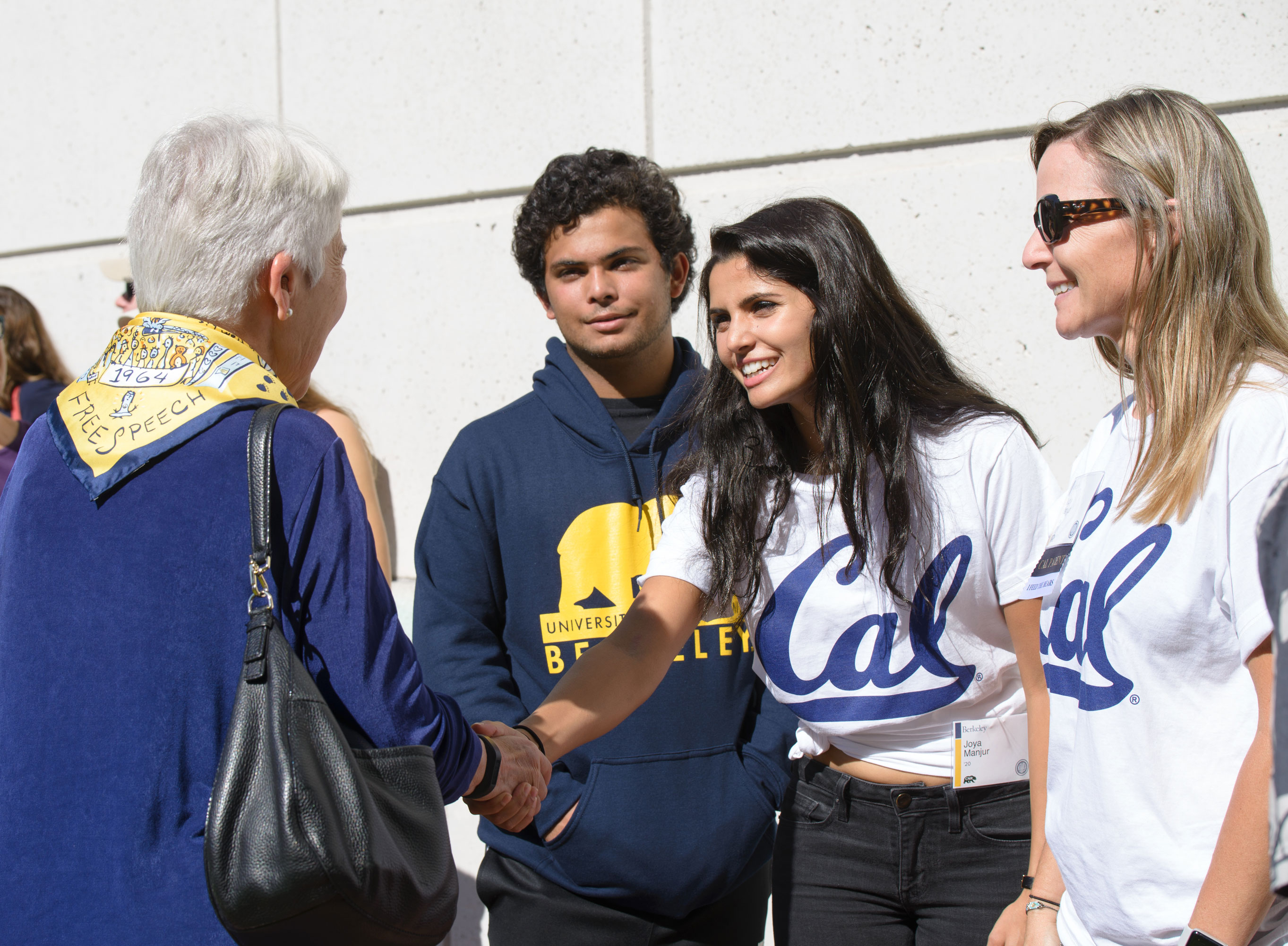 Cal student shaking hands with Chancellor Carol Christ
