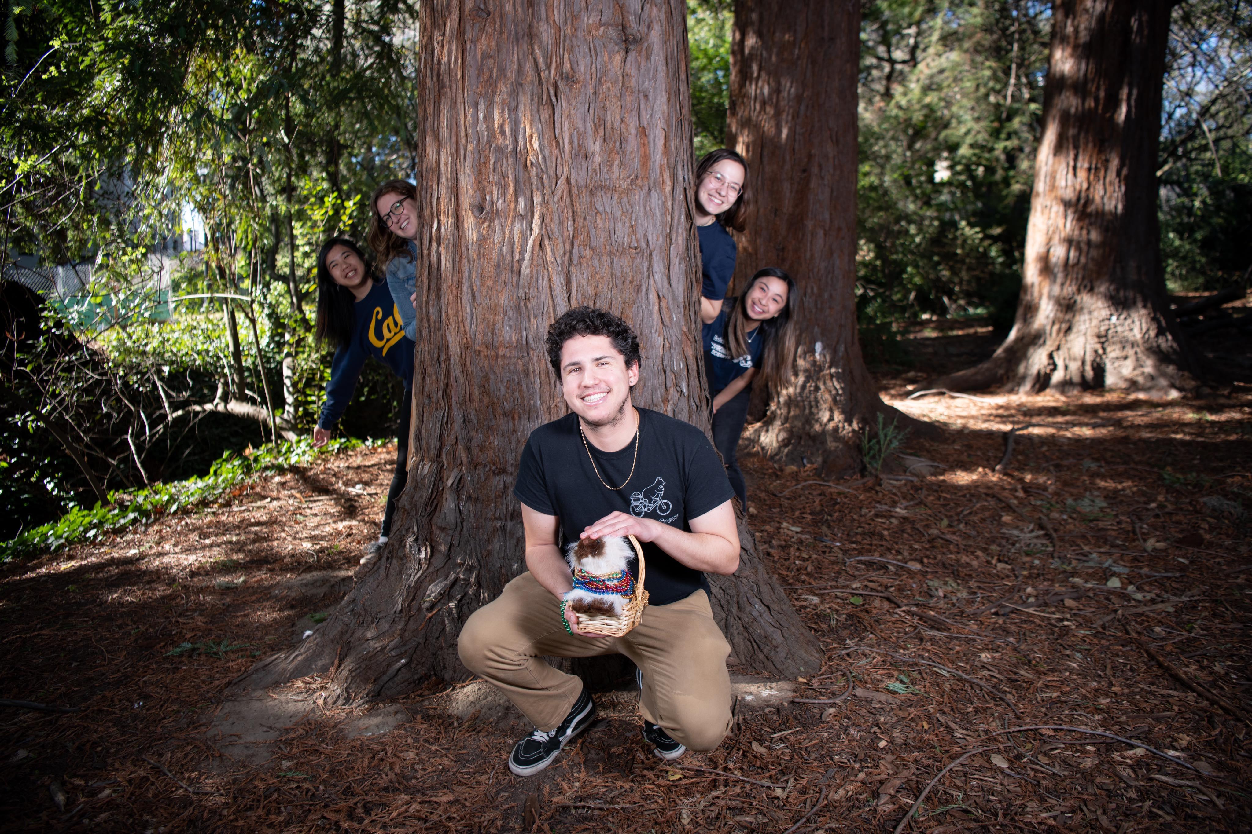 Dante Gonzalez sitting in front of a tree.