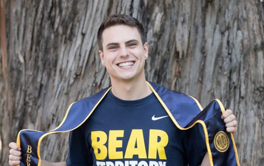 """Brian wearing a """"Bear Territory"""" shirt and his graduation stole."""