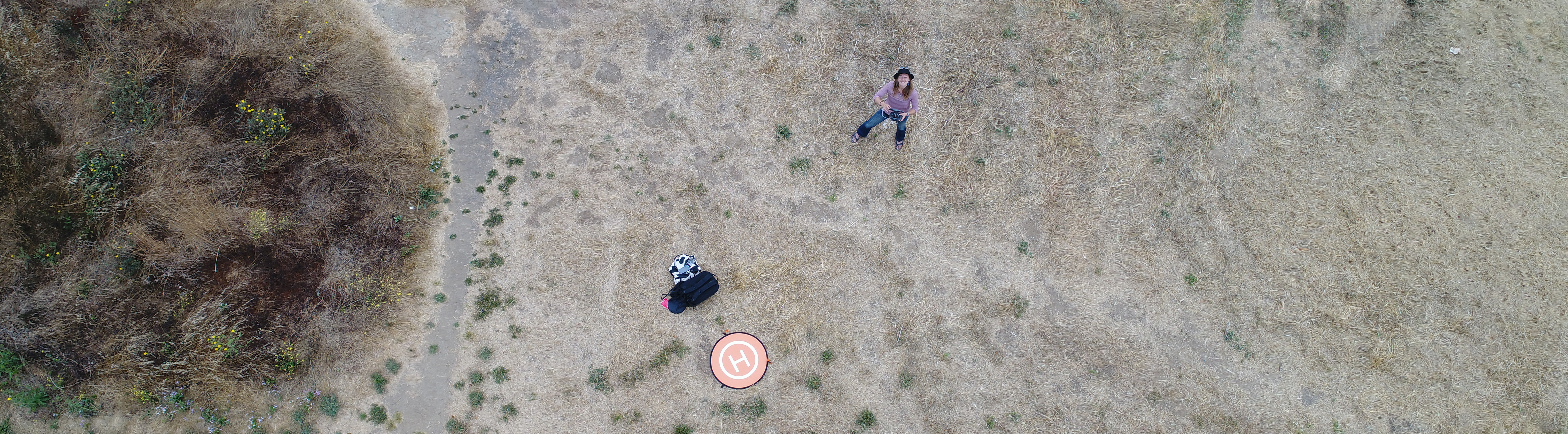 Chippie taking an aerial photo with her drone at Caesar Chavez Park in Berkeley, CA