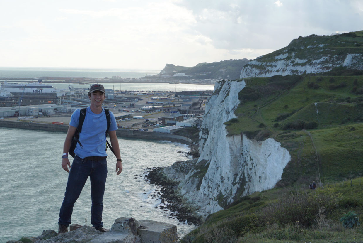KC Harris stands in front of England's Dover cliffs