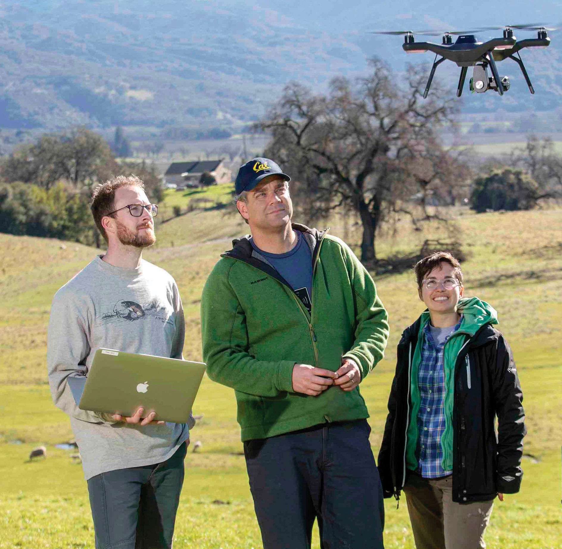 researchers with a drone