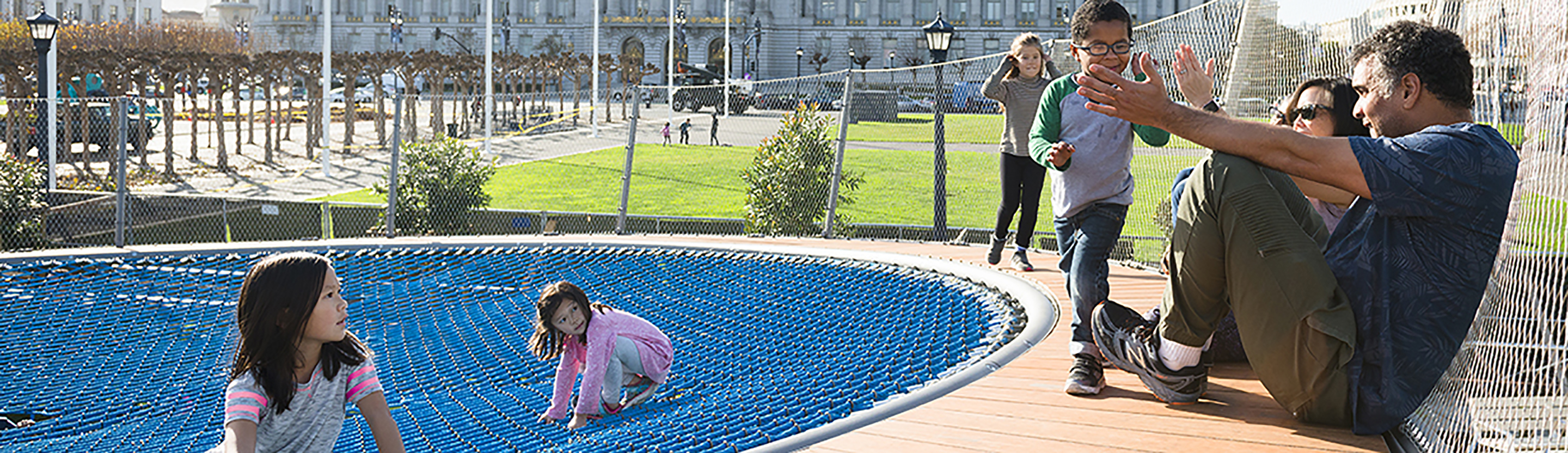 Family enjoying outdoor engagement in San Francisco's Civic Center