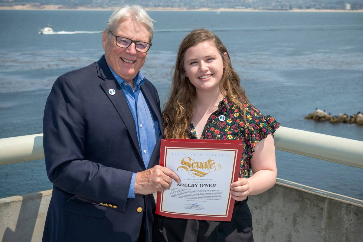 Shelby receiving a certificate from the Senate