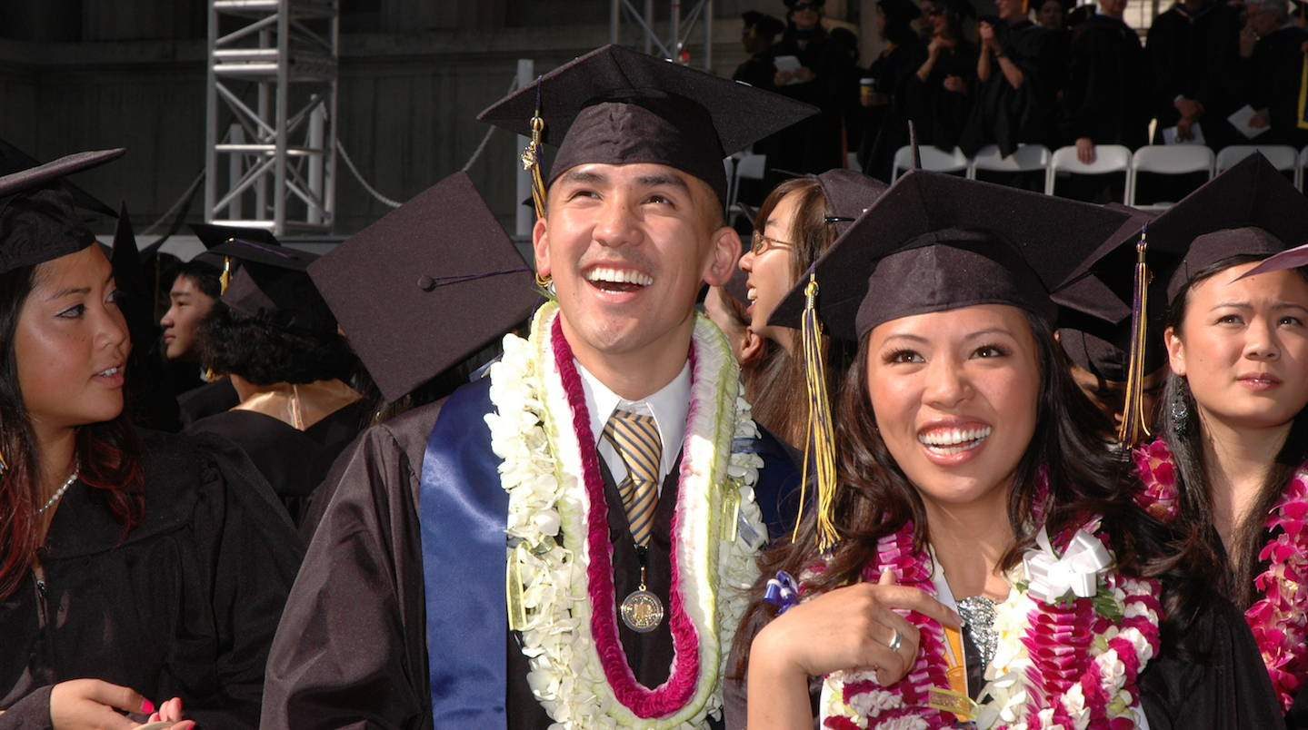 Smiling students at Commencement