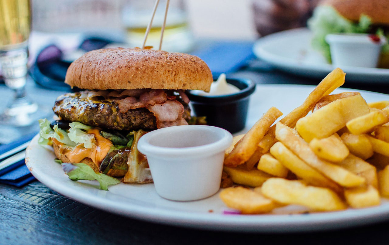 A plate with a burger and fries