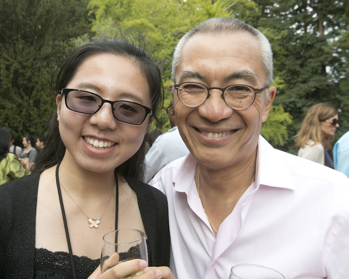 Advisory board member Mike Cheng with a student