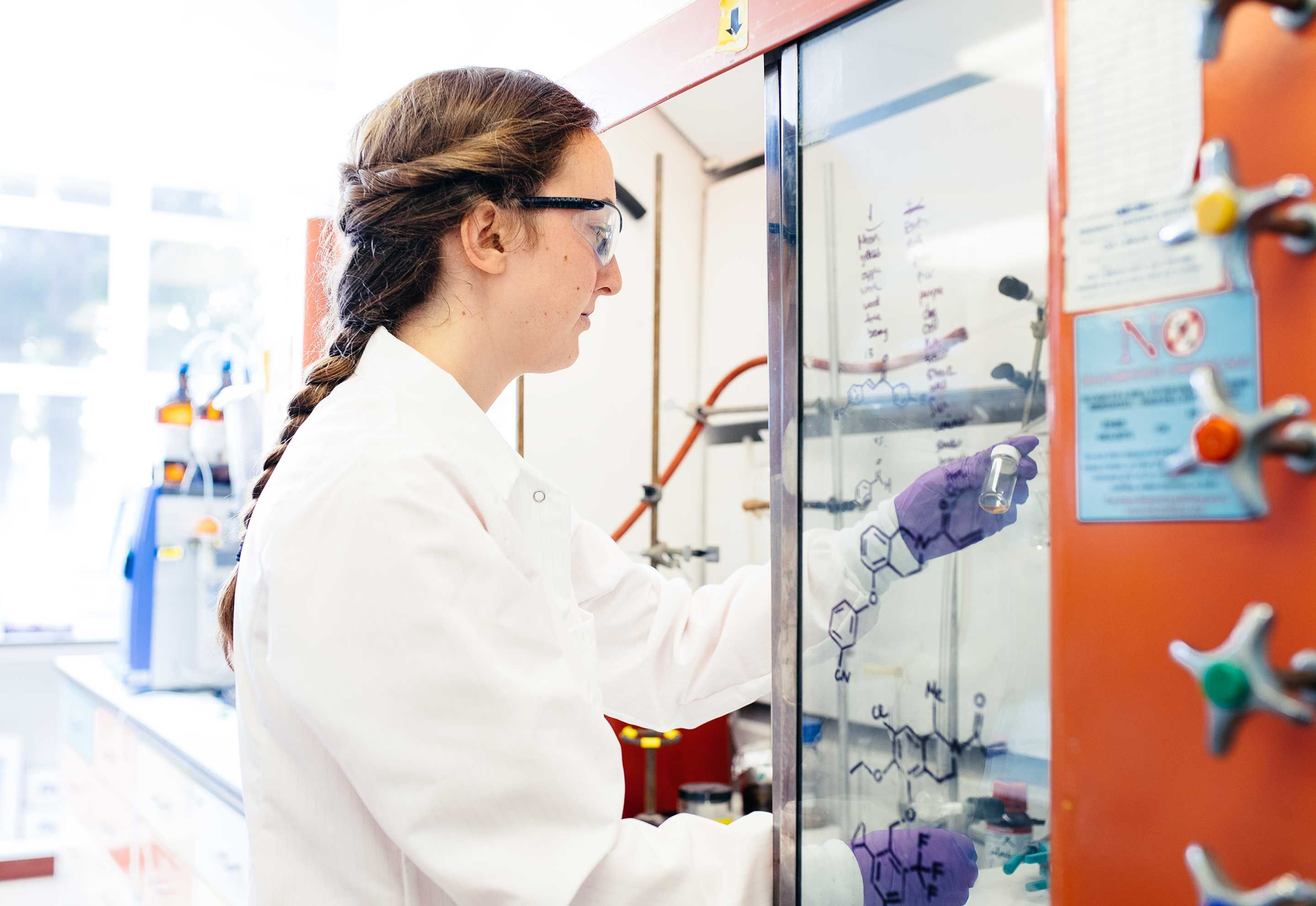 A researcher in a lab holding a test tube