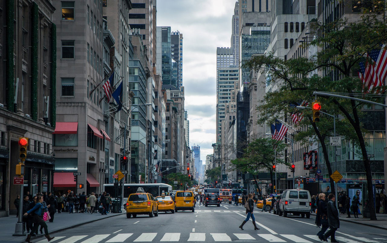 Street view of New York City with taxi cabs in background