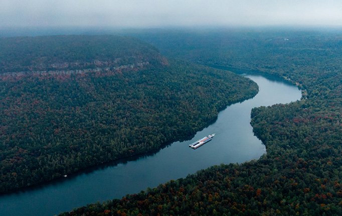 Aerial view of a river with a boat
