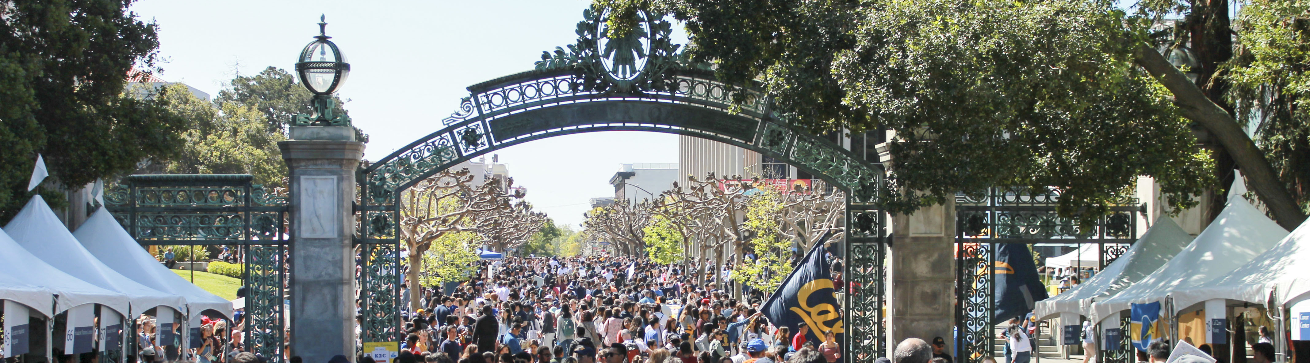 Sather gate on the UC Berkeley campus with many people walking underneath