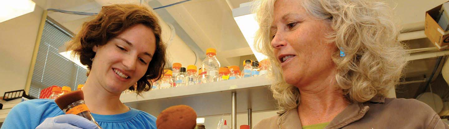 Louise Glass, professor and department dhair, Department of Plant and Microbial Biology, with student