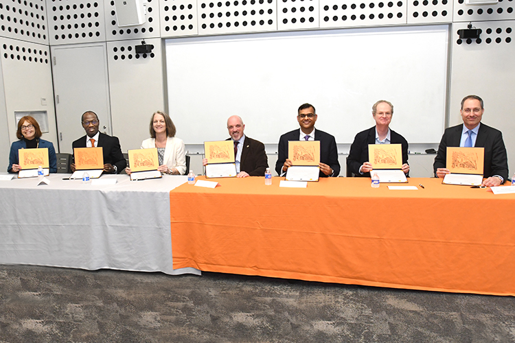 Attendees at a signing ceremony.