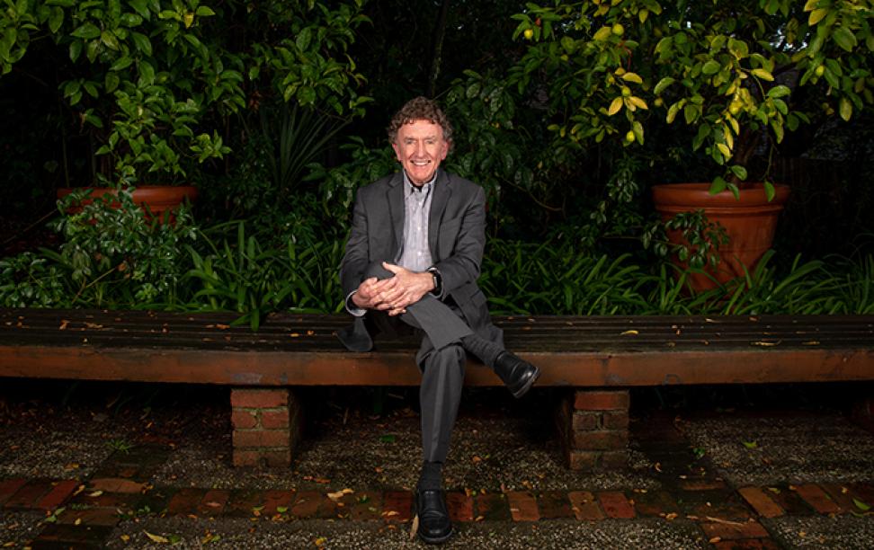 Gordon Rausser sitting in garden
