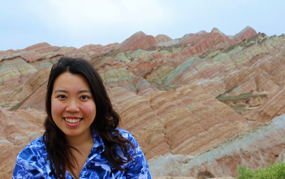 Kimberlie Le in front of a particularly colorful mountain.