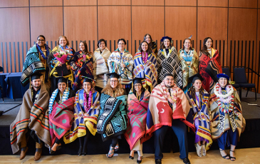 Students at UC Berkeley's American Indian Graduate Program commencement celebration in 2019