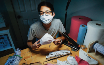 Researcher Christopher Gee making masks