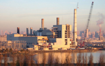 a coal plant at sunset