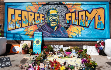 A mural and flowers memorializing George Floyd.