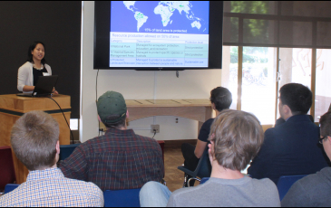 Student presenting at a research symposium