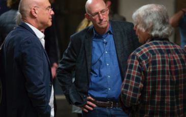 From left: Food writers Mark Bittman and Michael Pollan take with soil science professor Garrison Sposito Monday, Jan. 26, at the opening for the Edible Education course, now based at the College of Natural Resources.