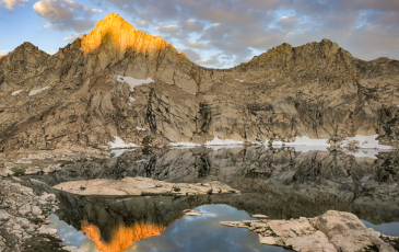 Sunrise over a mountain and lake