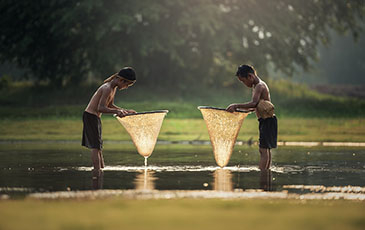 young boys fishing in Thailand