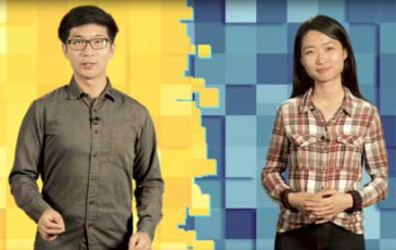 Two students stand in front of a green and blue screen