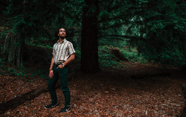 Lorenzo Washington standing in a forest.