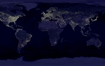 an aerial view of the earth lit up at night